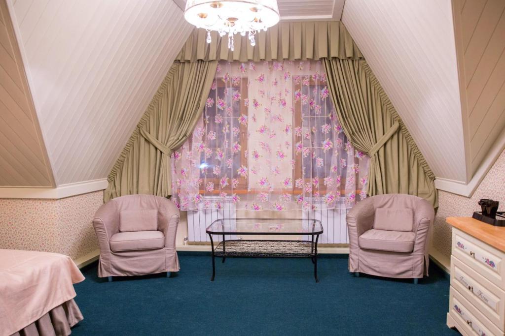 A seating area at Lesnaya Polyana