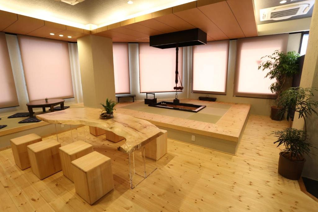 The lobby or reception area at Fuku Hostel Nagomi Namba