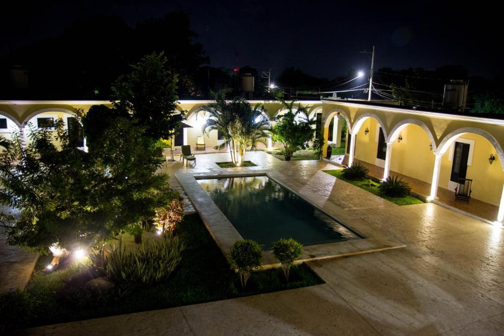 The swimming pool at or near Hotel Hacienda Izamal