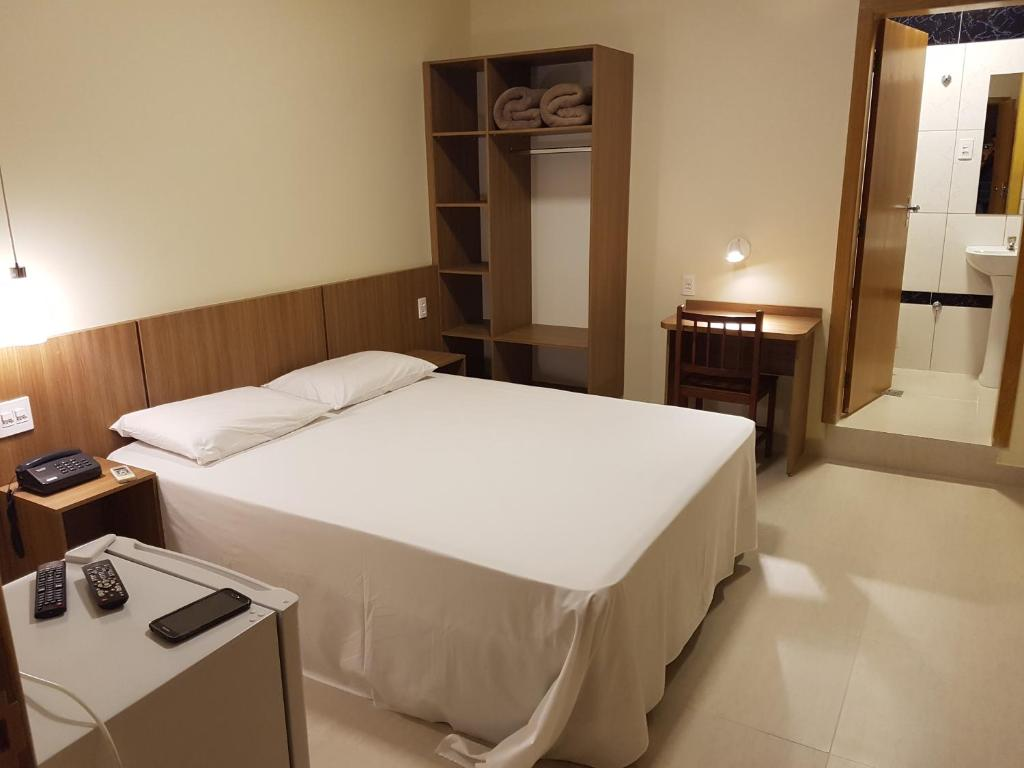 A bed or beds in a room at Oft Place Hotel