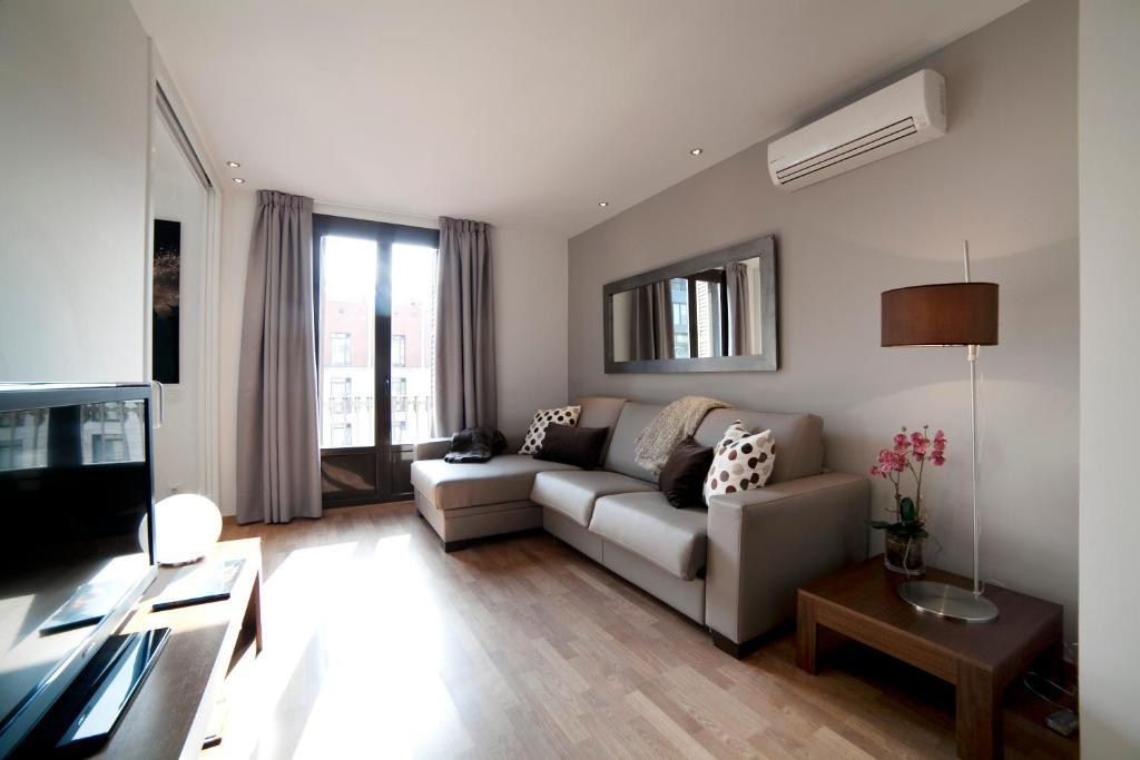 אזור ישיבה ב-Serennia Apartamentos Ramblas - Plaça Catalunya