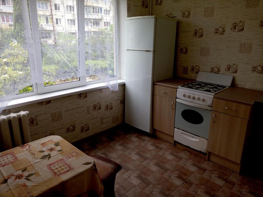 Кухня или мини-кухня в Комната в квартире на Павлова
