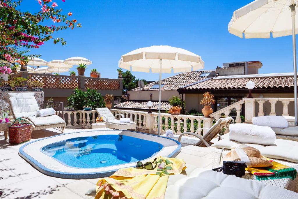The swimming pool at or close to Hotel Villa Taormina