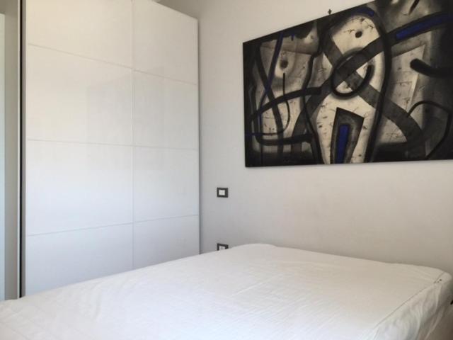 Een bed of bedden in een kamer bij Piazzetta 470