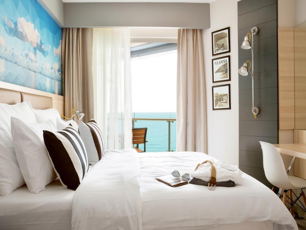 Кровать или кровати в номере Sunprime C-Lounge - Adult Only