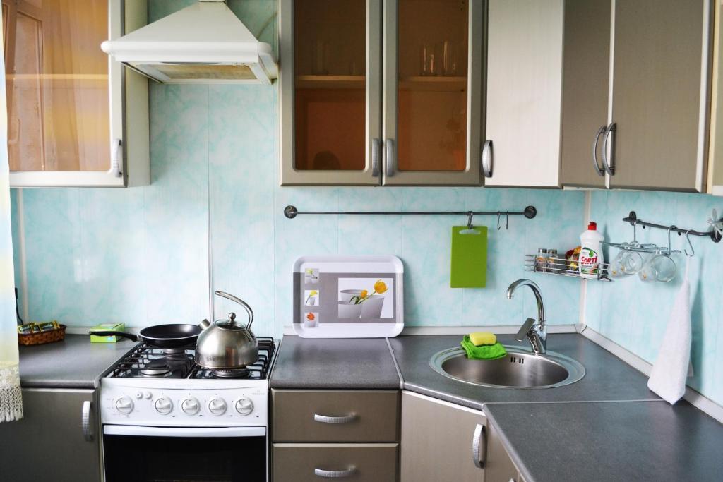 A kitchen or kitchenette at Leningradskaya Apartments