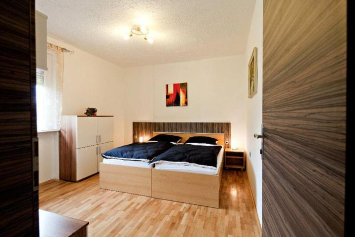 A bed or beds in a room at Guest House Šempeter