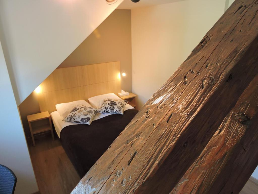 Ein Bett oder Betten in einem Zimmer der Unterkunft Auberge Communale de St-Légier