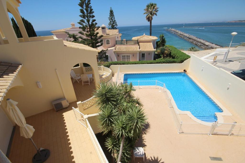 A view of the pool at Villa Falesia by amcf or nearby