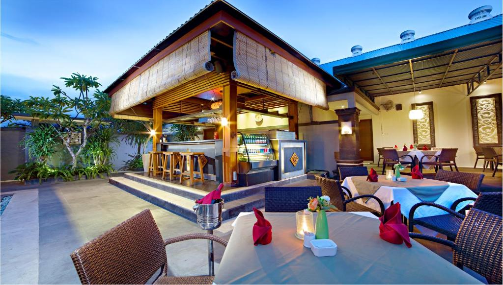 A restaurant or other place to eat at The Banyumas Villa