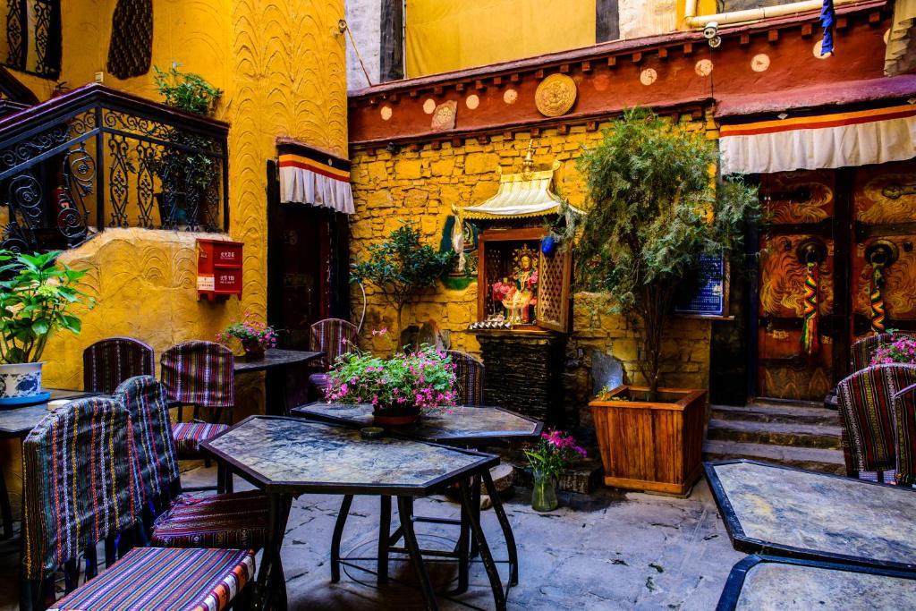 The lounge or bar area at House Of Shambhala