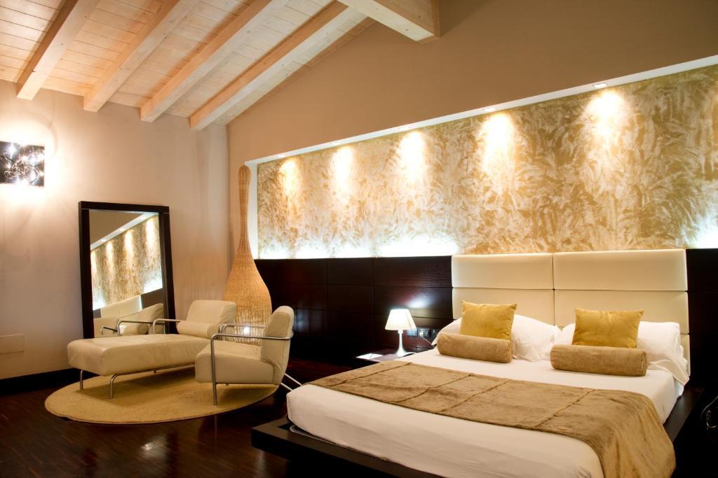 Letto o letti in una camera di OneMhotel