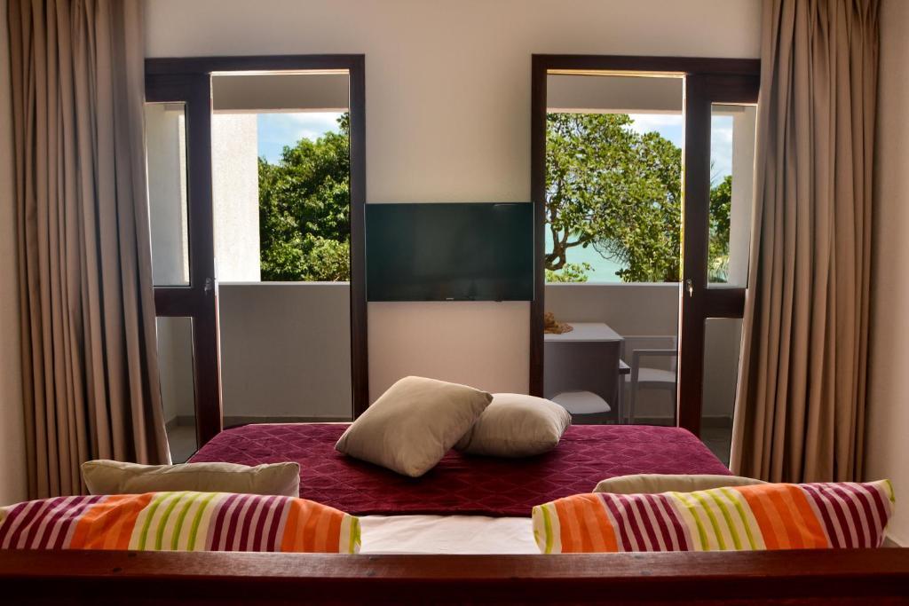 Cama ou camas em um quarto em Vila da Pipa Suítes