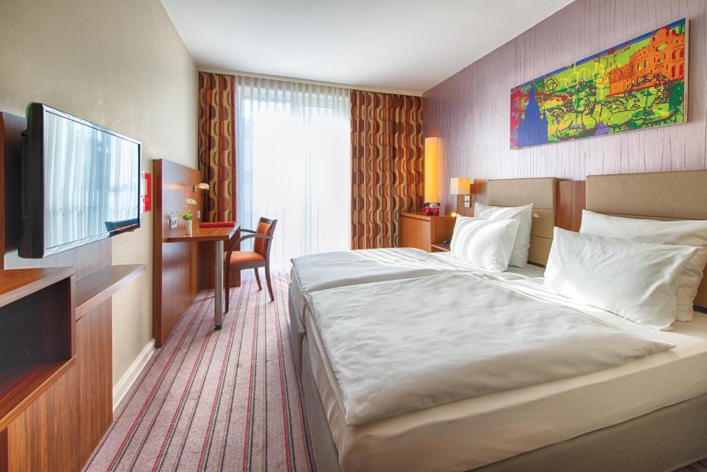 Ein Zimmer in der Unterkunft Leonardo Hotel Dresden Altstadt