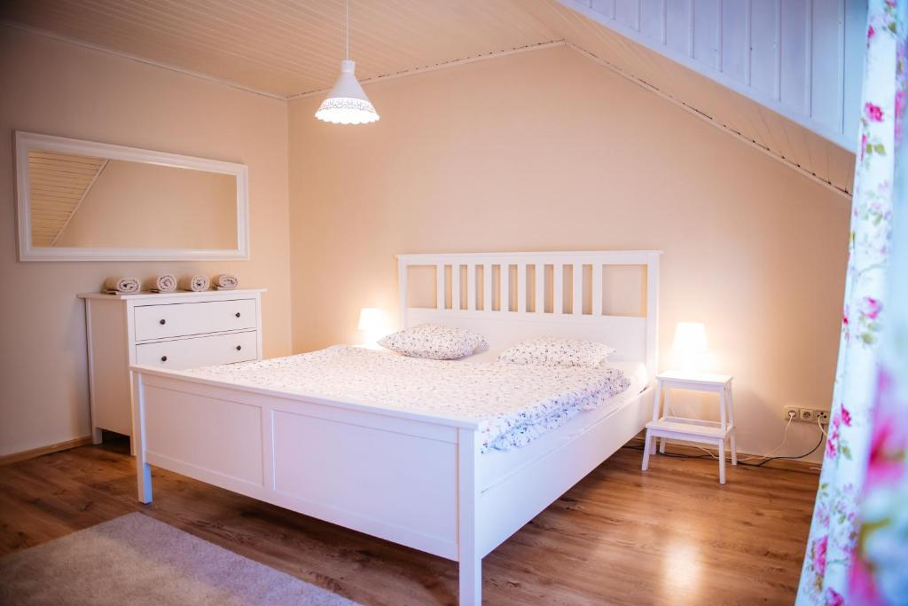 A bed or beds in a room at Turciansky dvor - Apartmany Turiec