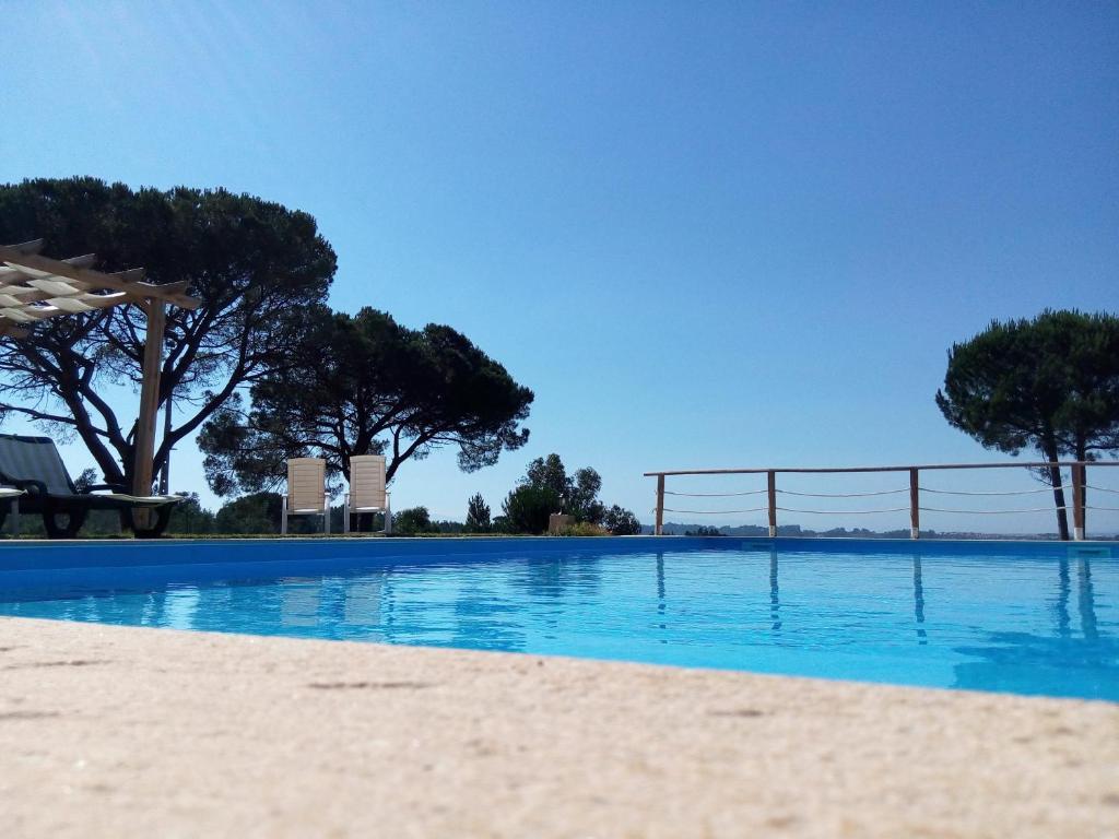 The swimming pool at or near Villa Travancinha