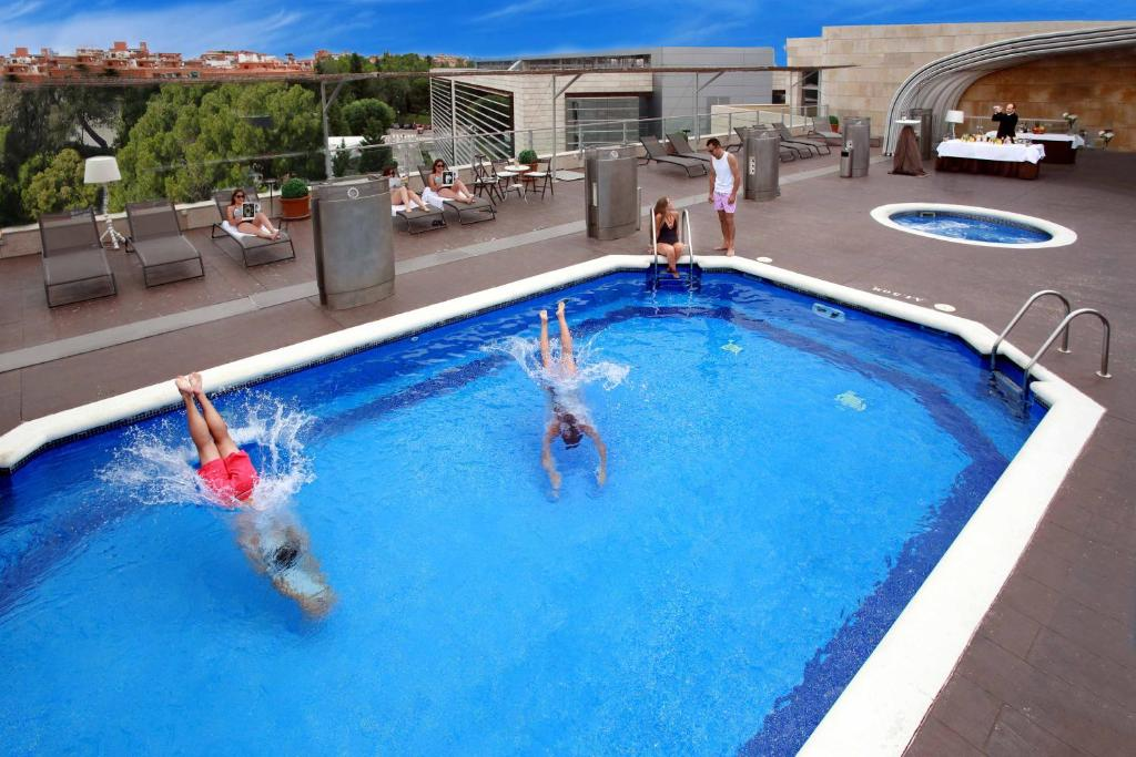 The swimming pool at or near Amura Alcobendas