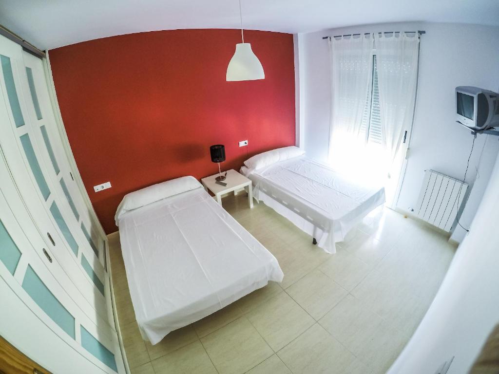 A bed or beds in a room at La Casa De Belicena