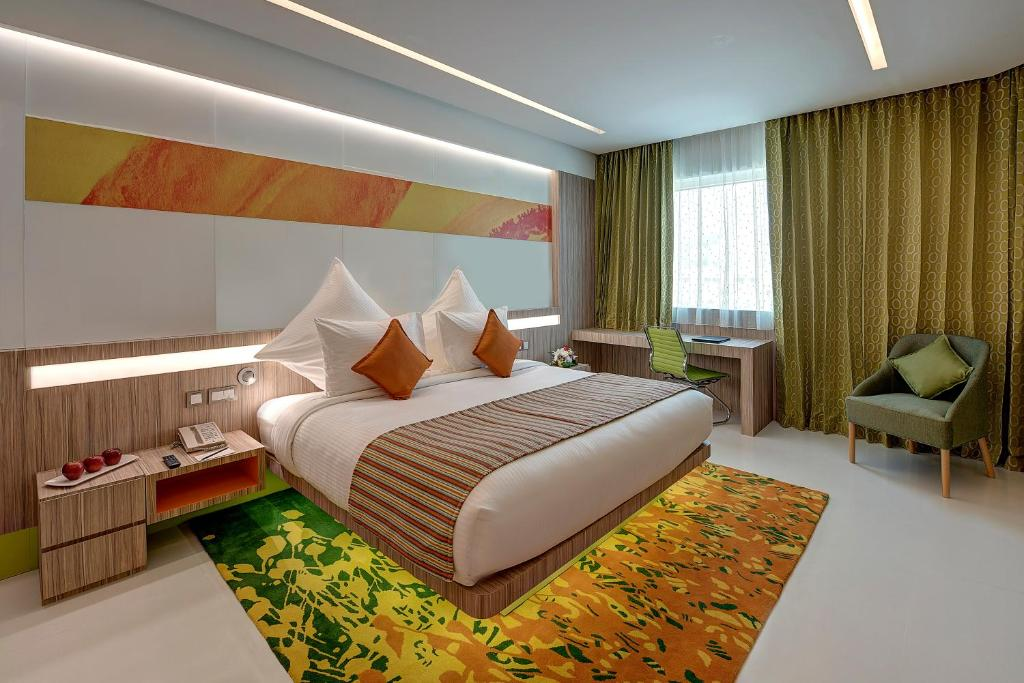 A bed or beds in a room at Al Khoory Atrium