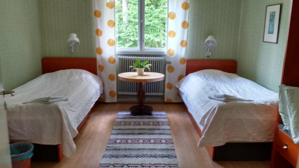 A bed or beds in a room at Moshults Vandrarhem