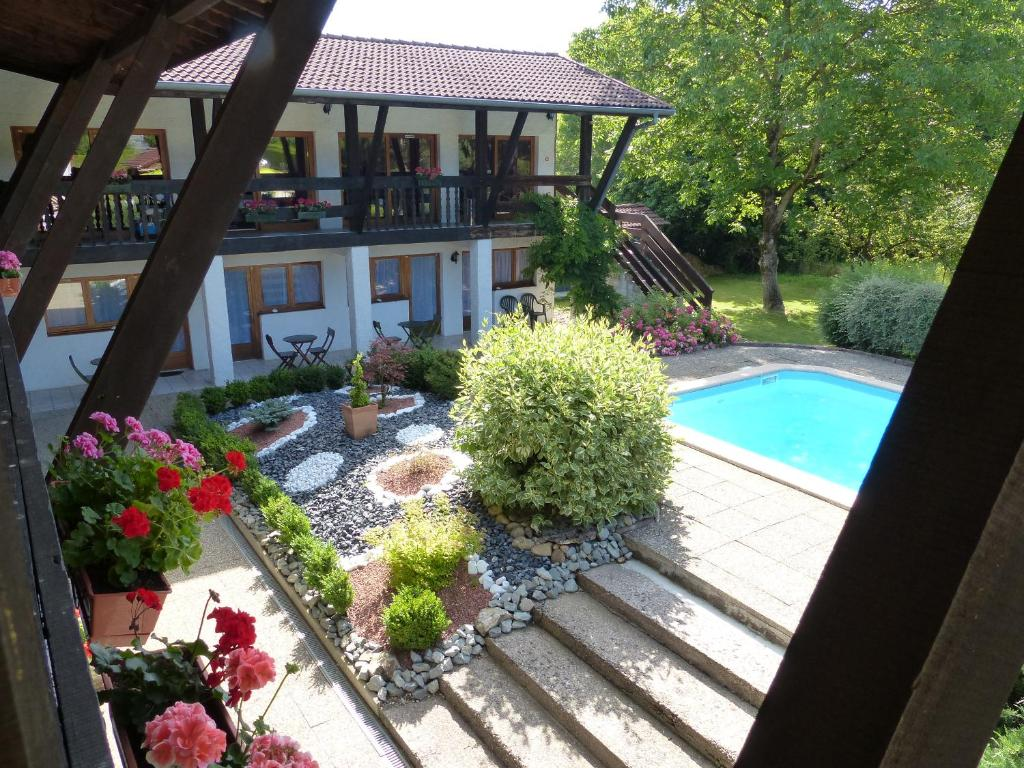 The swimming pool at or near La Vieille Ferme