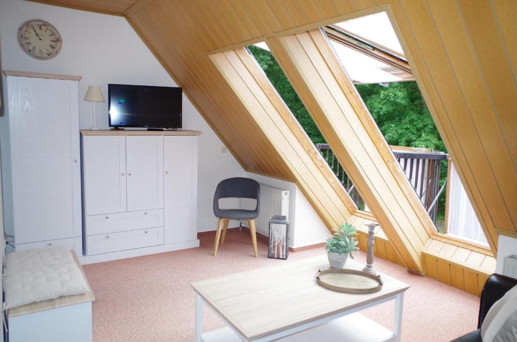 Ein Sitzbereich in der Unterkunft Zur Eselwiese, Haus I