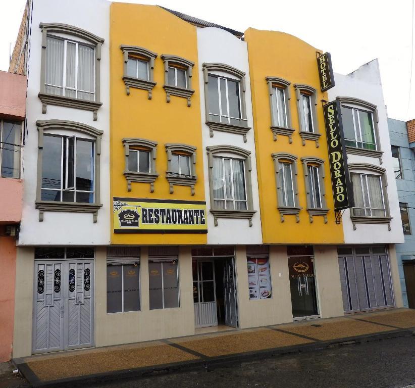 La fachada o entrada de Hotel Sello Dorado