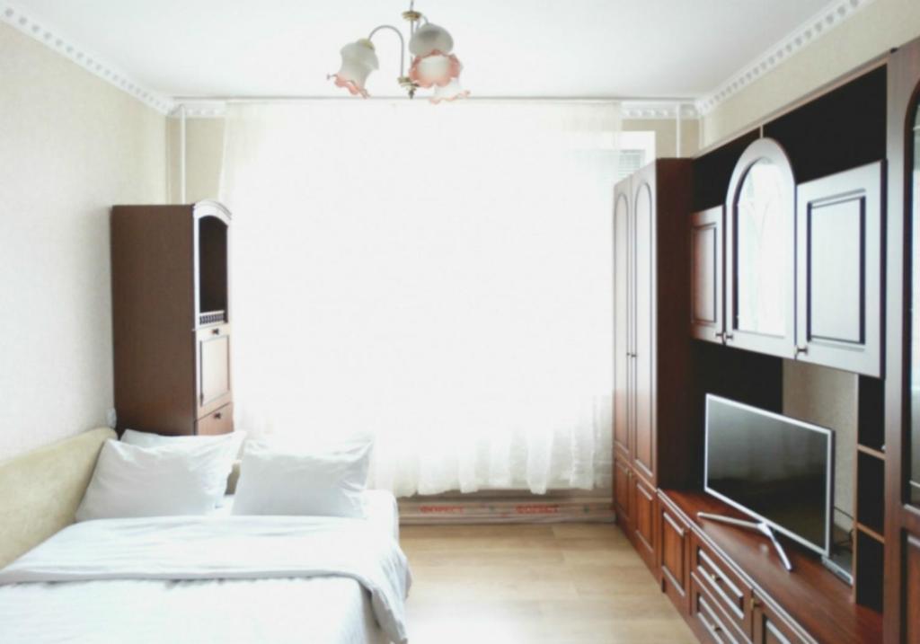 A bed or beds in a room at Inndays Apartment Podolsk VLKSM