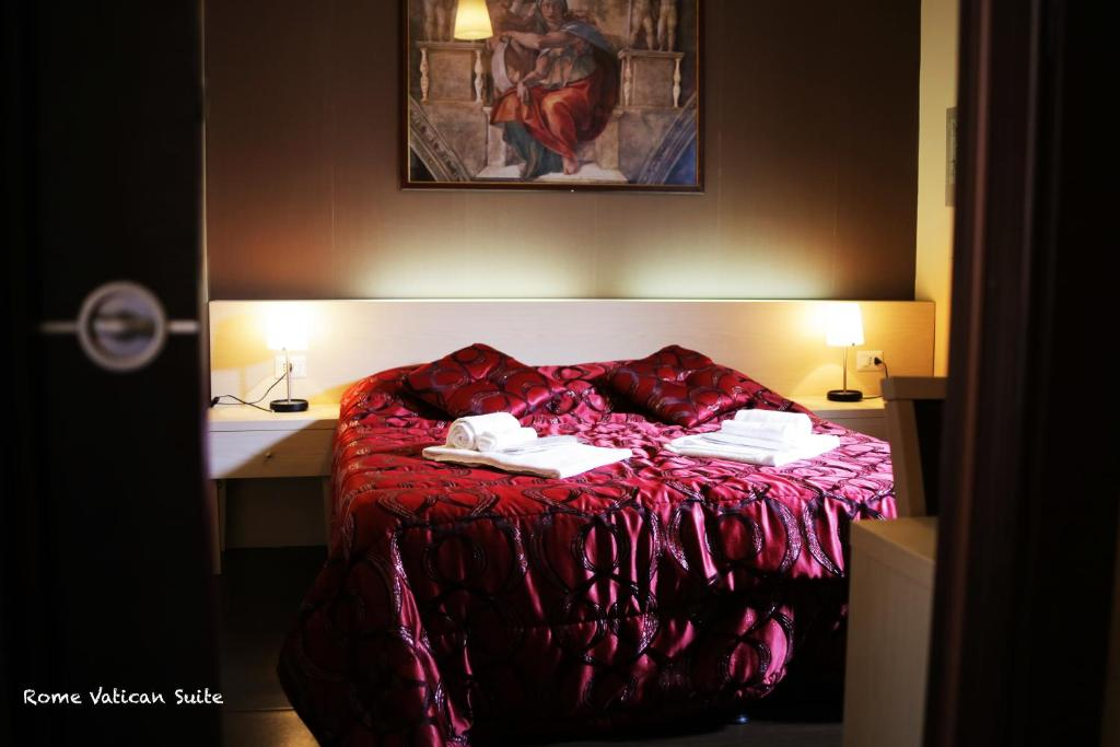 A bed or beds in a room at Rome Vatican Suite