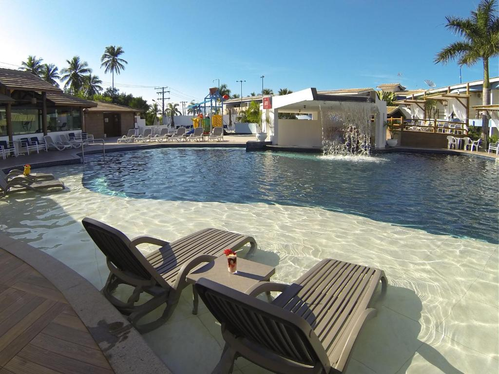 The swimming pool at or near Sued's Plaza