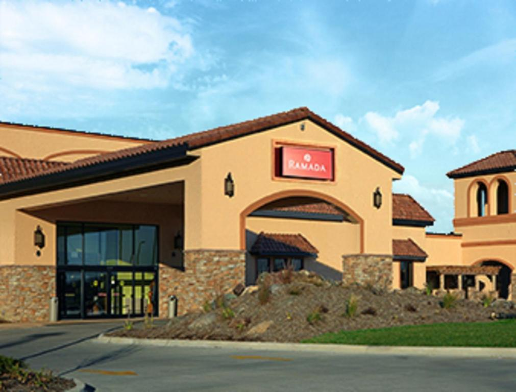 The facade or entrance of Ramada by Wyndham Des Moines Tropics Resort & Conference Ctr