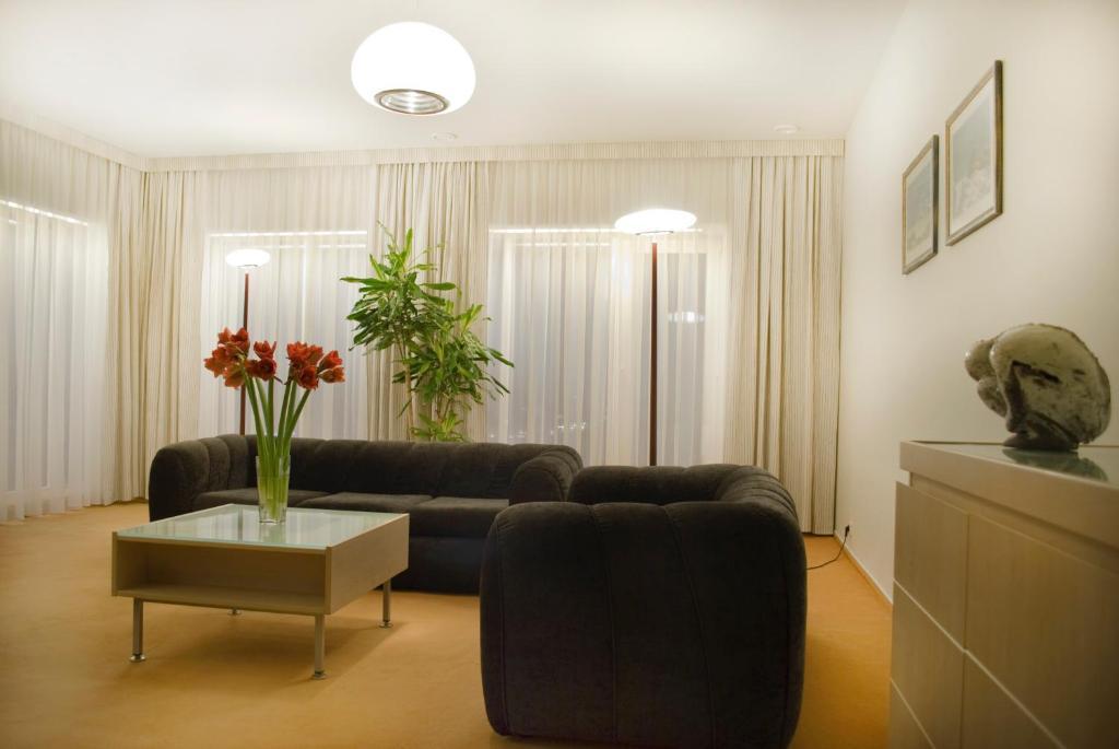 Svetainės erdvė apgyvendinimo įstaigoje Hermis Hotel