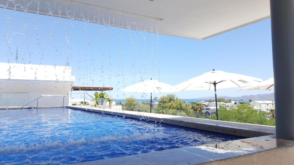 The swimming pool at or near Hotel Catedral La Paz