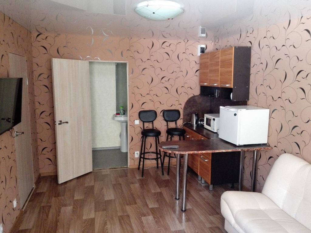 A kitchen or kitchenette at Timiryazevskiy pereulok 4 Apartment