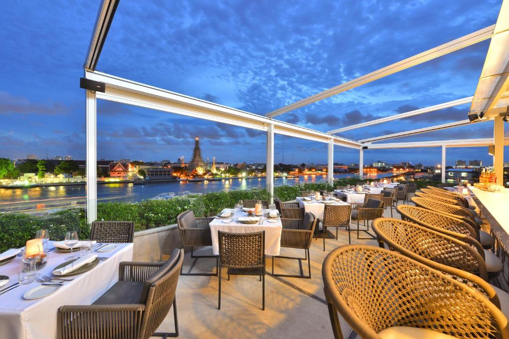 A restaurant or other place to eat at Riva Arun Bangkok