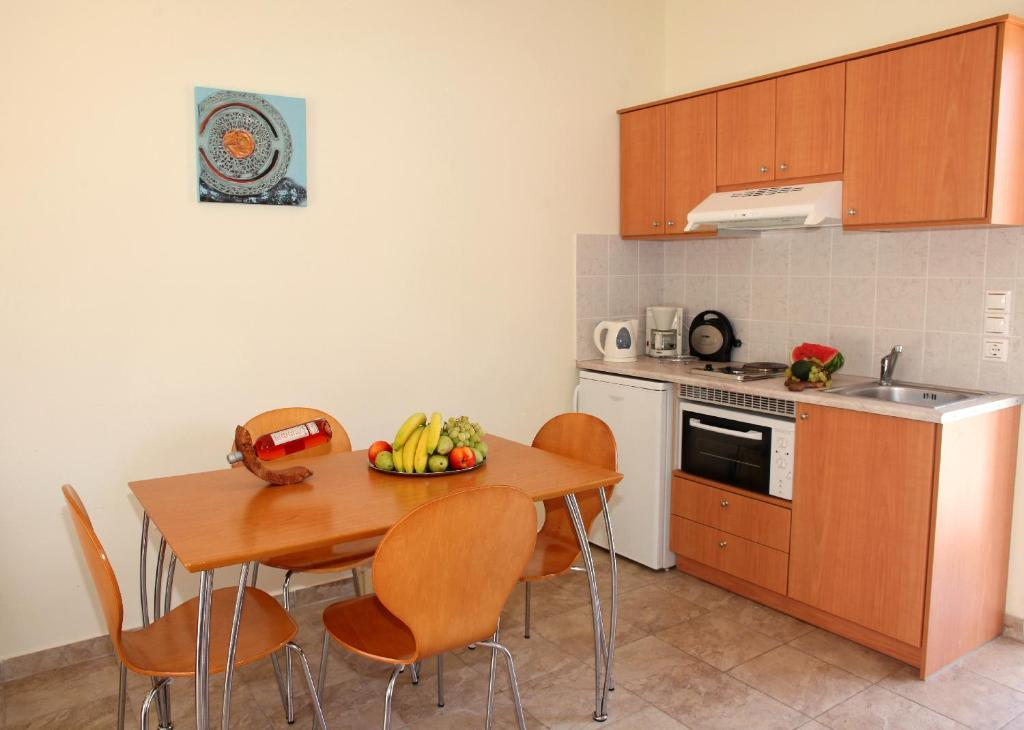 A kitchen or kitchenette at Natura Studios