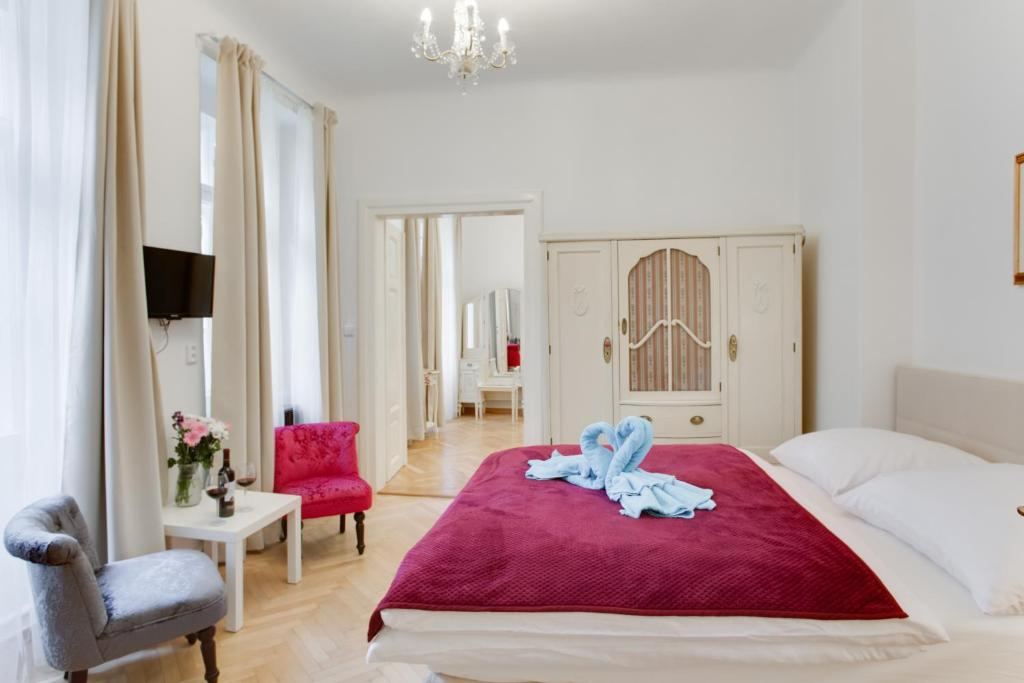 A bed or beds in a room at Prague Siesta Apartments