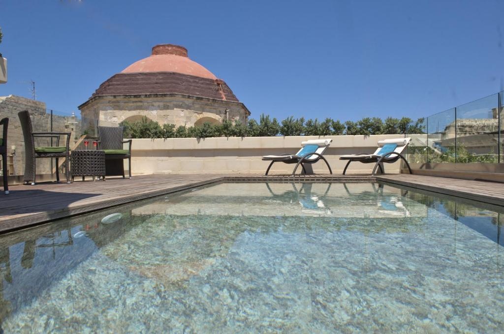 The swimming pool at or near Palazzo Consiglia