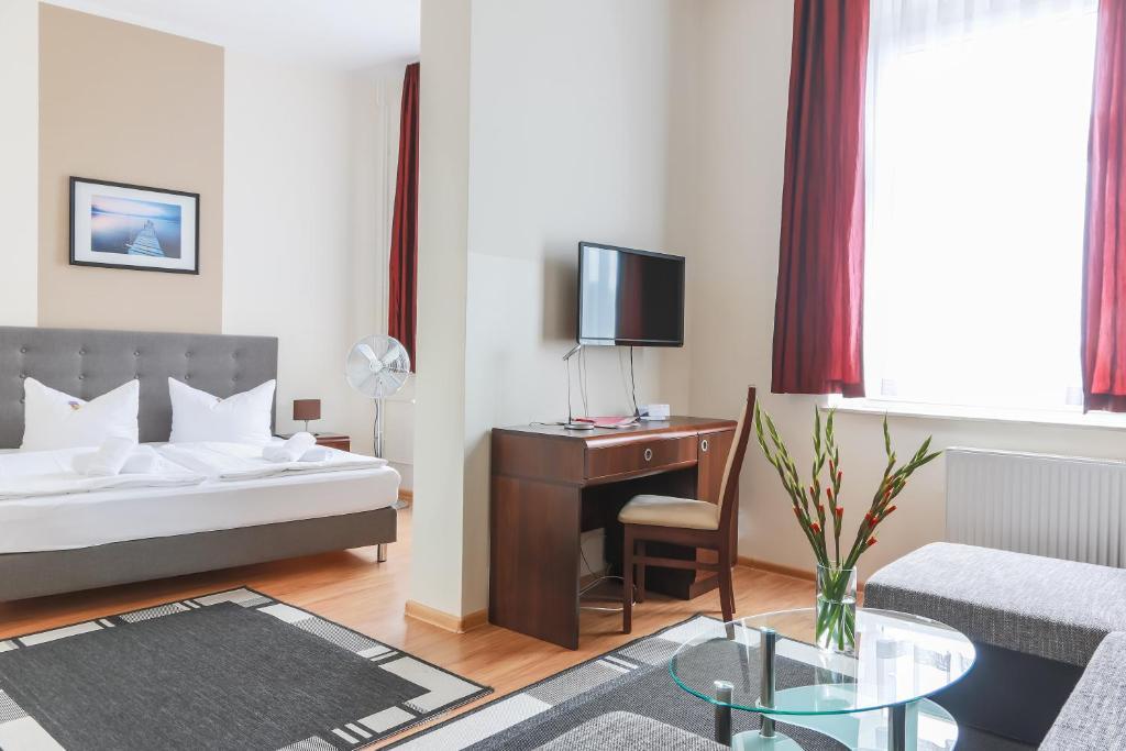 Ein Bett oder Betten in einem Zimmer der Unterkunft City Residence Hotel Frankfurt Oder Bahnhof