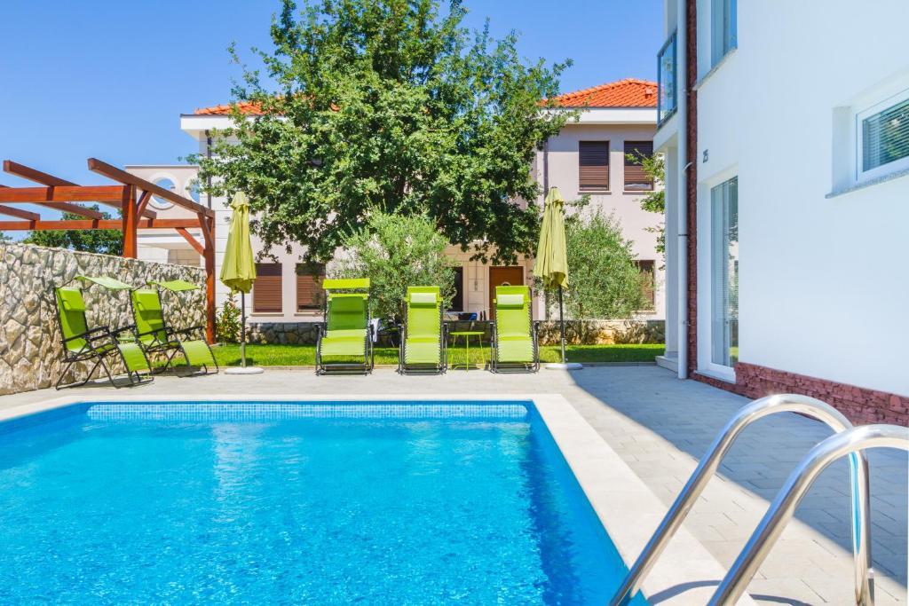 The swimming pool at or close to Villa Apartments Futura