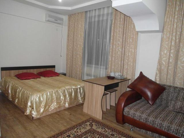 A bed or beds in a room at Kuze Hotel