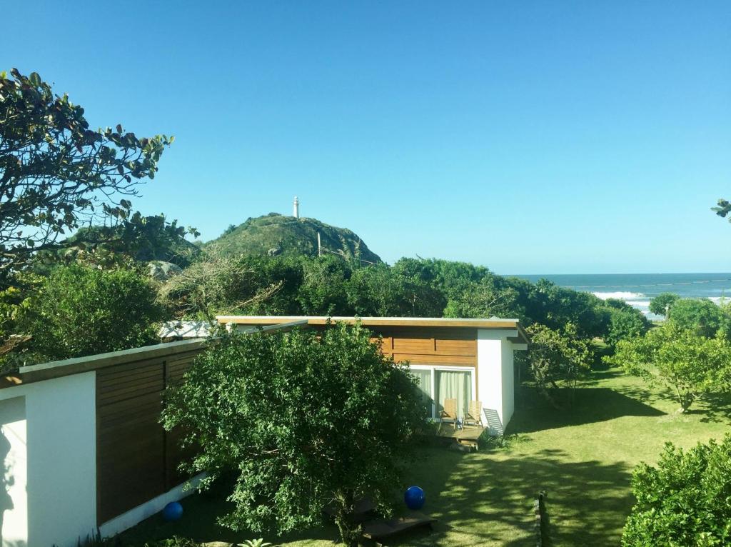 A garden outside Casa da Ilha do Mel - Pousada de Charme