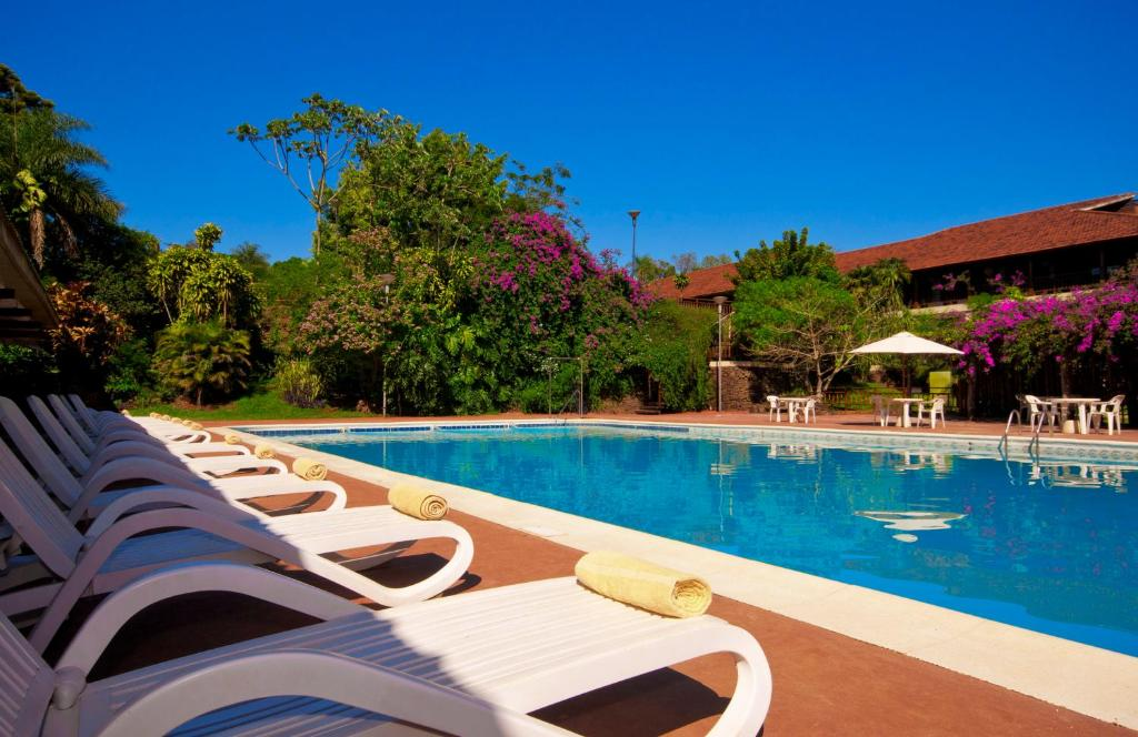 The swimming pool at or near Hotel Raices Esturion