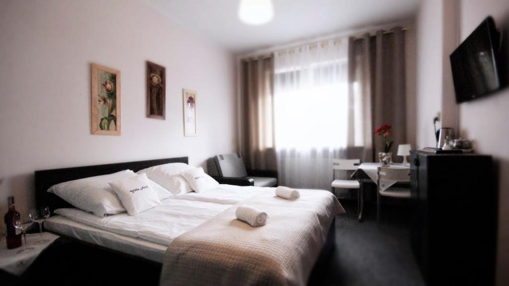 Łóżko lub łóżka w pokoju w obiekcie Villa Alris