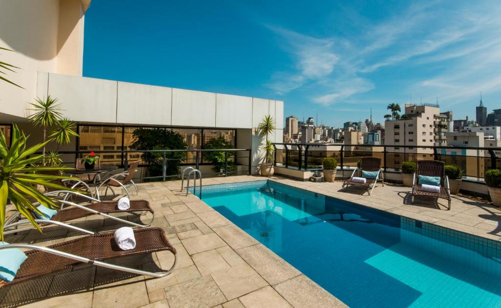 The swimming pool at or near Transamerica Executive Jardins