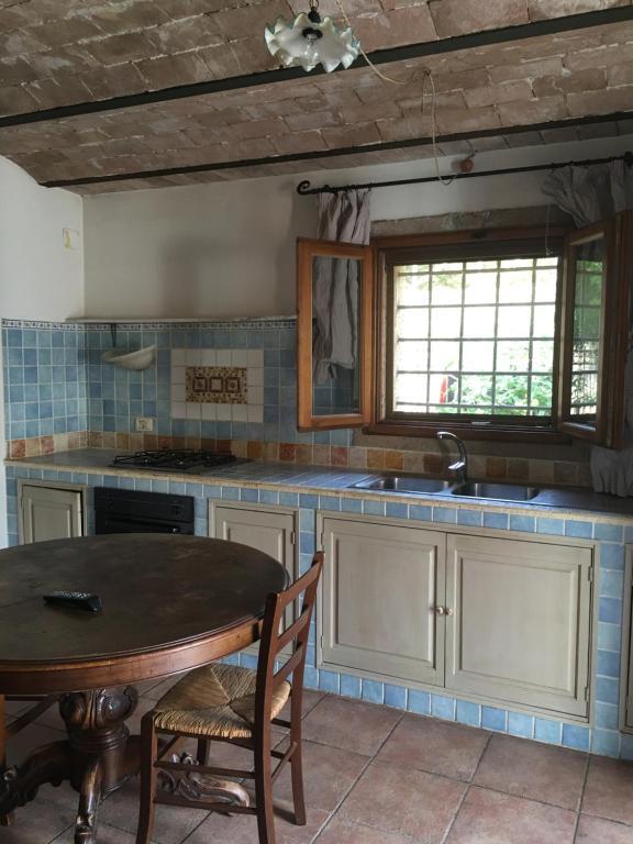 Küche/Küchenzeile in der Unterkunft Case Ballerini