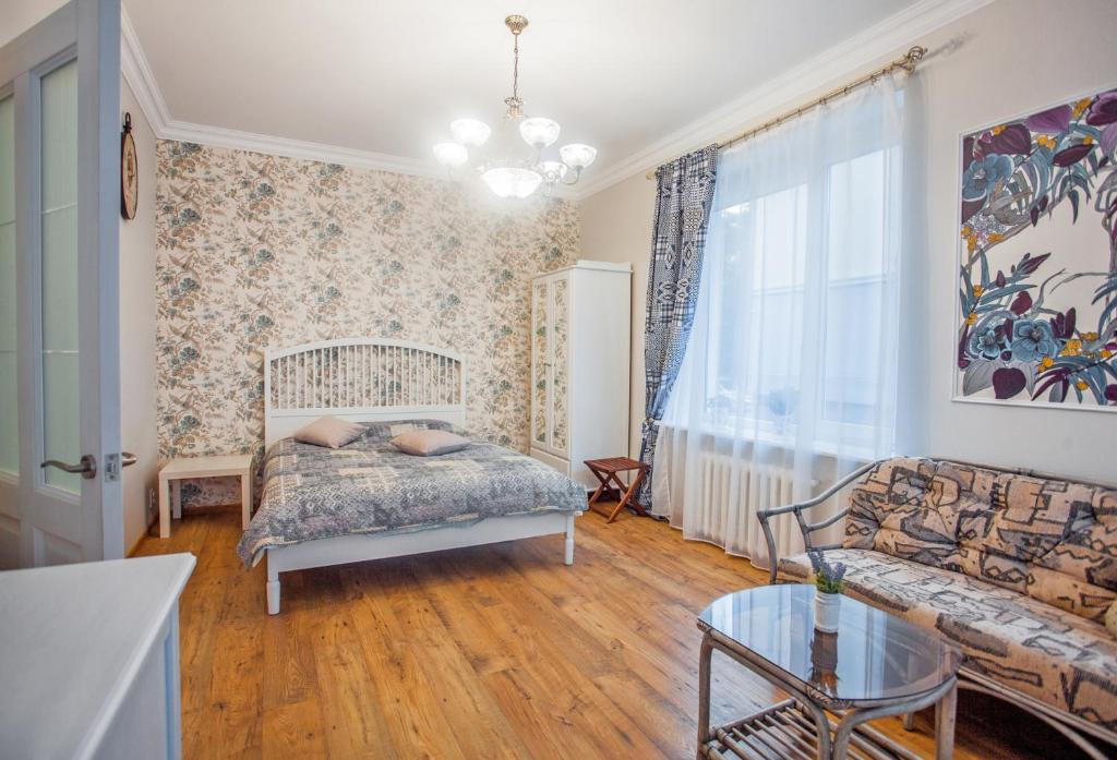 A bed or beds in a room at Apartment Na Krasnoy