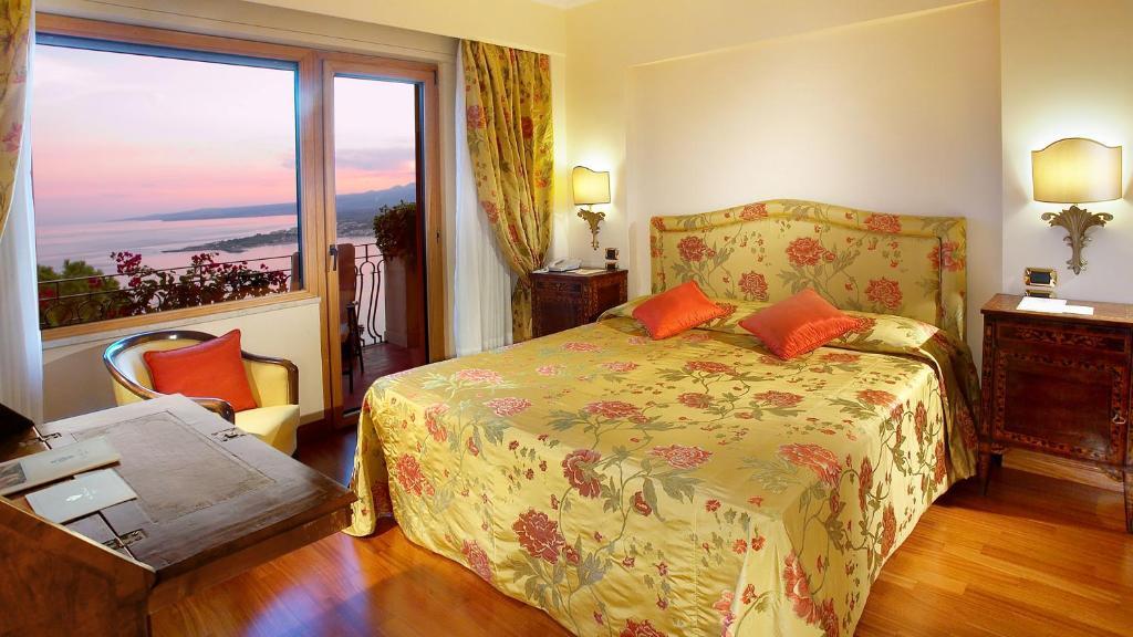 ヴィラ ディオドロ ホテルにあるベッド