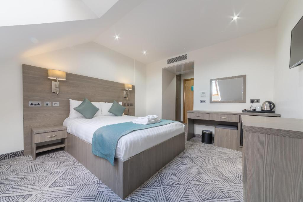 Llit o llits en una habitació de The Lion & Key Hotel
