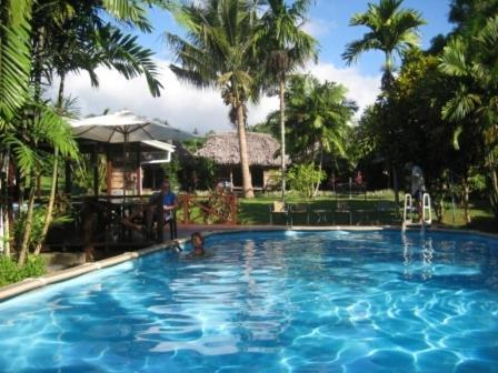 The swimming pool at or near The Samoan Outrigger Hotel